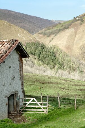 Idyllic farmhouse shed in the French pyrenees mountains against the Spanish border (Basque country) photo