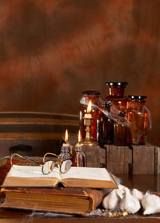 Halloween witchs kitchen with poison bottles and books photo