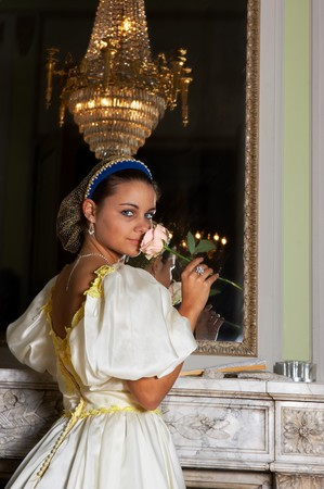 Beautiful young victorian lady in front of a mirror in Castle