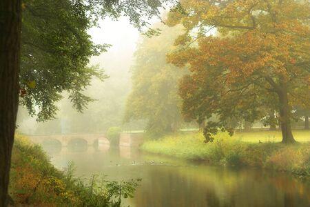 mists: Castle bridge on a misty autumn morning