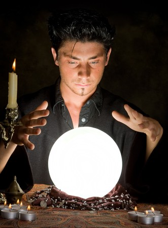 Halloween scene of a young sorcerer and his crystal ball Stock Photo - 7686185