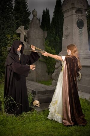 cloak and dagger: Victorian lady holding a pistol towards an evil monk at halloween