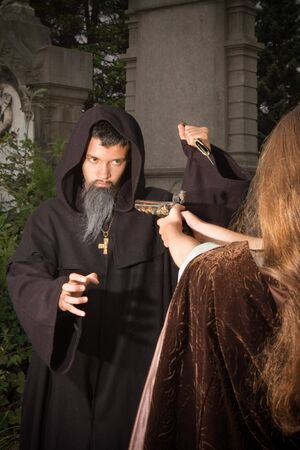 cloak and dagger: Victorian lady defending herself against an evil monk at halloween