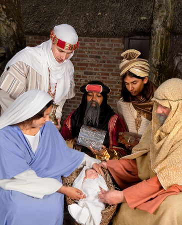 Live Christmas nativity scene reenacted in a medieval barn Stock Photo - 7795413