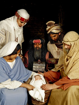 Live Christmas nativity scene reenacted in a medieval barn Stock Photo - 7795412