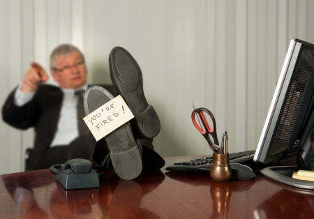 superiors: Office manager firing an employee with a yellow sticky note on his shoe