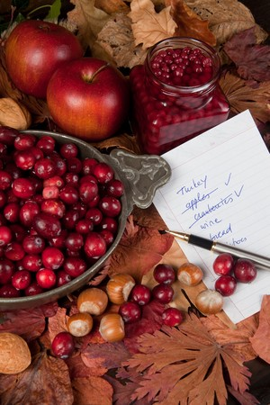 Shopping list with thanksgiving ingredients, cranberries and apples photo