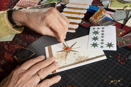 scrapbook homemade: Hands of a woman crafting and scrap-booking christmas cards Stock Photo