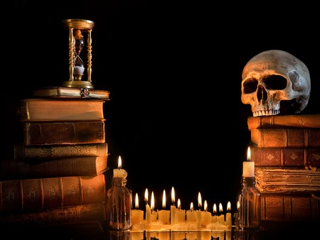 Halloween border with skull, ancient books and candles Stock Photo - 7795422