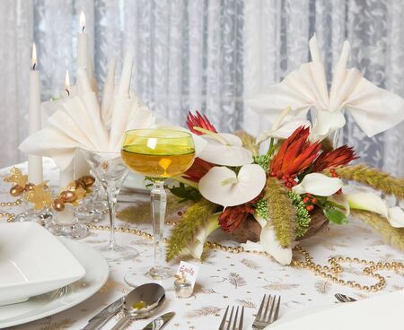 Elegant Christmas or Wedding table with flower arrangement and prawn cocktail photo