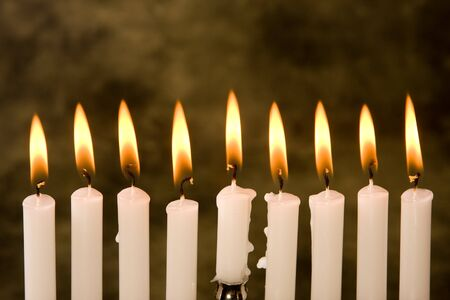 Nine candles for the jewish holiday hanukkah photo