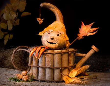 gourds: Figurine made of autumn materials like gourds, leaves, acorns Stock Photo