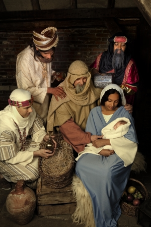 caspar: Live Christmas nativity scene reenacted in a medieval barn --- Note to editor :  the baby is a doll. Stock Photo