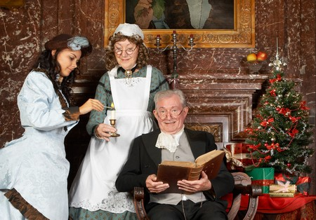 Vintage christmas scene of a victorian family.Shot in the antique castle