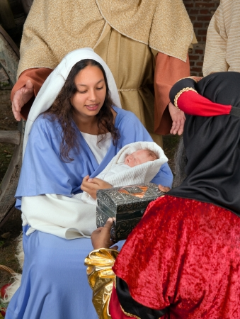 Live Christmas nativity scene reenacted in a medieval barn with the three wisemen or magi Stock Photo - 7914340
