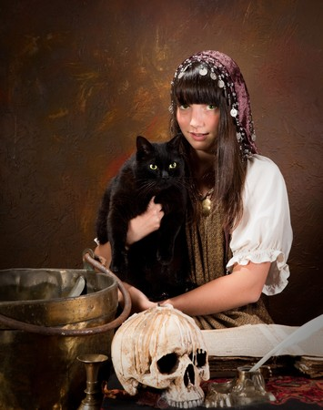 gypsy woman: Halloween witch holding her black cat with green eyes (the book is 300 years old, no copyright problems)