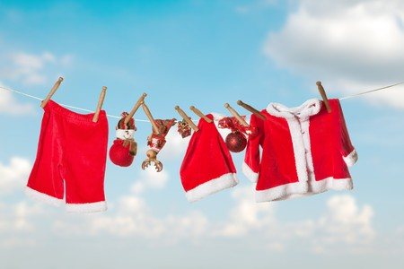 seasonal clothes: Santa claus laundry hanging on a clothesline in the sky Stock Photo