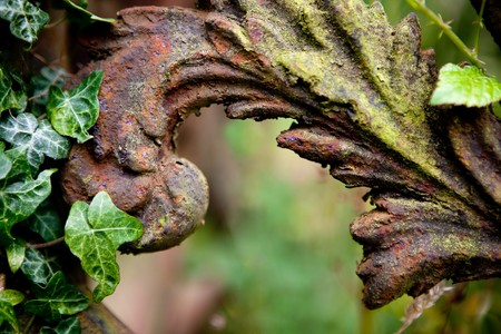 Rusty detail of a medieval grave decoration in Lacock village in England photo