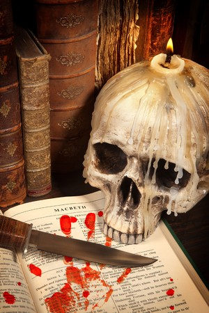 Shakespeares Macbeth with old books and a dagger photo