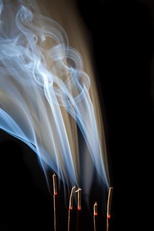 wisps: Incense burning with beautiful smoke fumes and wisps