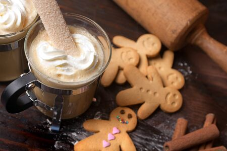 gingerbread: Gingerbread men cookie biscuits with hot coffee and whipped cream
