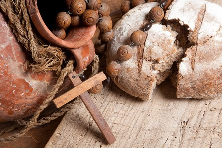 Antique wine jug, rosary and rustic loaf of bread as christian symbols of faith Stock Photo - 8018349