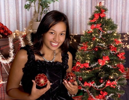 Young sexy woman holding christmas decorations Stock Photo - 8020558