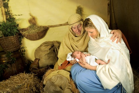 nativity: Reenactment of the christmas nativity scene with real people Stock Photo