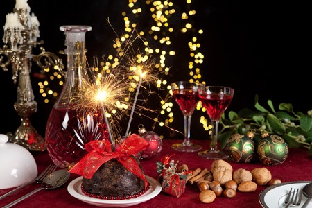 light meal: Christmas dinner table with xmas pudding as dessert Stock Photo