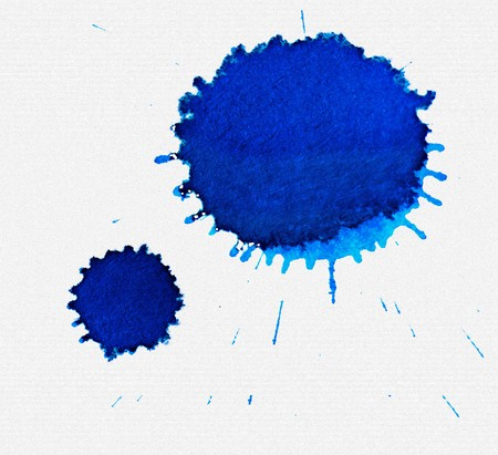 blot: Two large blue dried ink spots on textured white paper
