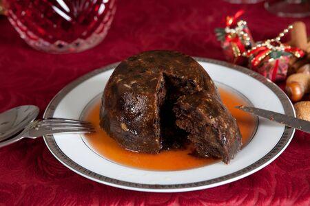 Christmas dinner table with xmas pudding as dessert photo