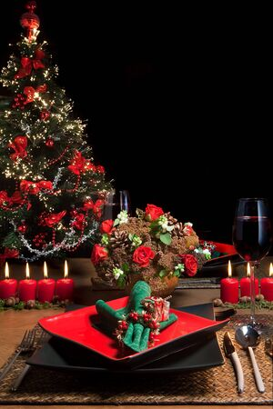 Christmas dinner table with elegant napkins in red and green photo