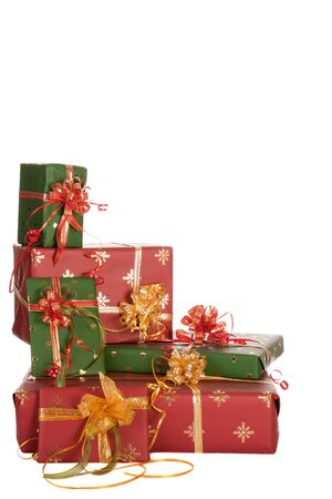 gift packs: Isolated stack of christmas presents in red and green Stock Photo