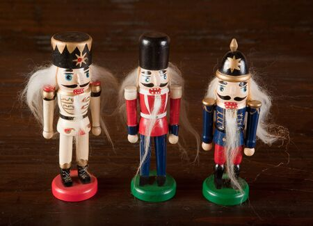 Three nutcracker solders or antique wooden toys photo