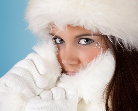 Winter girl with white fur hat wearing warm woolen gloves Stock Photo - 8202077