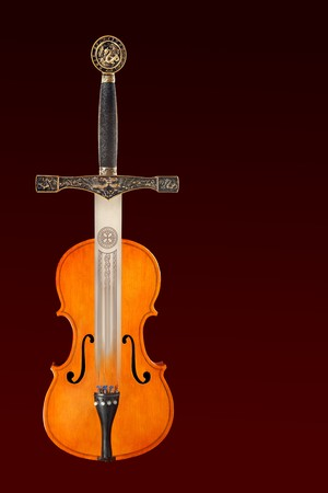 Combined image of a medieval sword and a classical violin photo