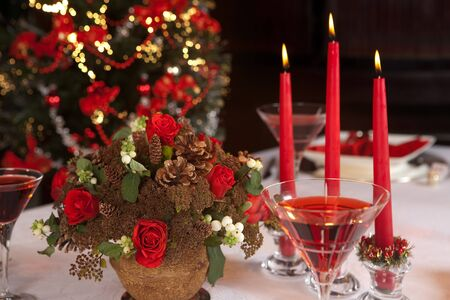 Christmas table with red napkins and candles photo