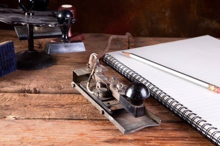 telegraphic communication: Vintage desk with antique telegraph and stamps Stock Photo