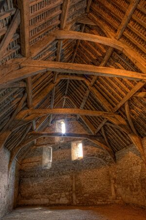 english village: Interior of a medieval tithe barn in the village of Lacock in Wiltshire England