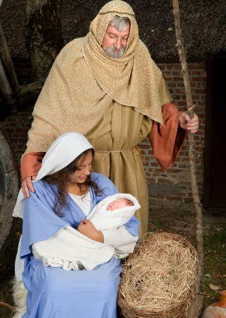 Live Christmas nativity scene reenacted in a medieval barn Stock Photo - 8374352