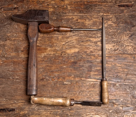 Border frame of rustic grunge carpenter tools photo