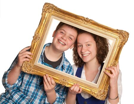Two teenagers posing holding a picture frame