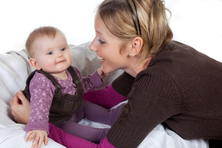 Loving mother playing with her four months old baby girl Stock Photo - 8419474