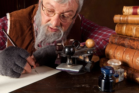 fountain pen writing: Vintage scene of an old man working in an antique office