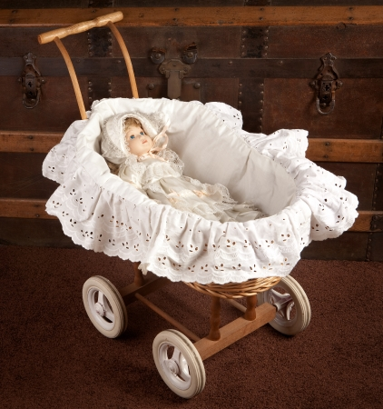 cradle: Antique doll lying in a wooden vintage cradle Stock Photo
