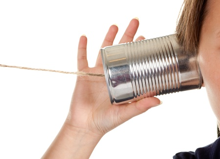strings: Female hand making a phone call through a can and wire Stock Photo