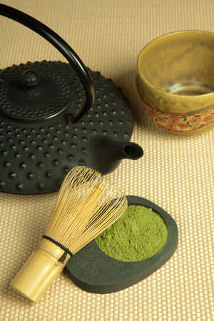 Green tea and Japanese wire whisk made of bamboo for tea ceremony photo