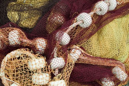 Colorful fishing nets in the port of Saint-Jean-de-Luz in Basque country in France photo