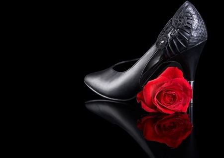 high heeled shoe: One reflected red rose and one high heeled sexy shoe