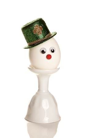 Egg wearing a St. Patrick's hat with eyes and nose Stock Photo - 8560977